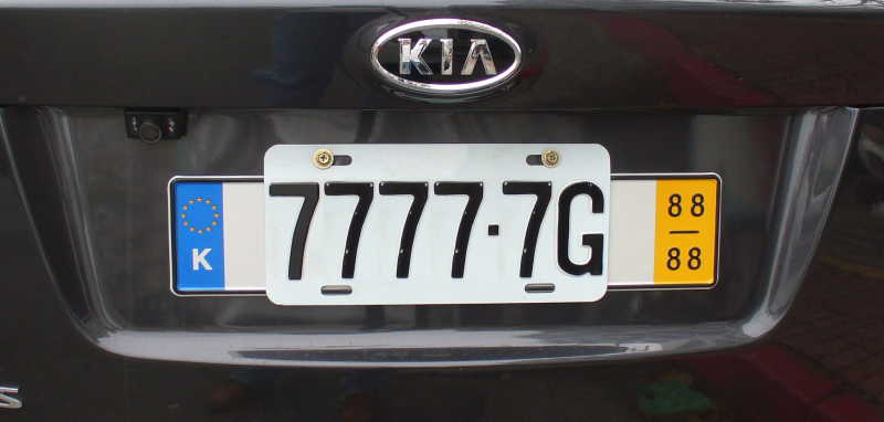 Taiwanese license plate over German license plate with K nation code